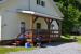 small deck with door to carriage house