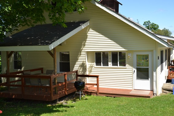 carriage house with covered deck