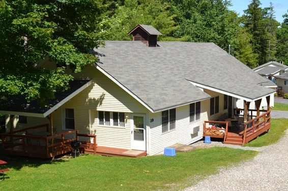 large carriage house with 2 decks