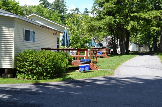 cottages next to driveway with front porch