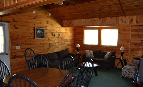 wood paneled living room with window
