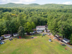 aerial view of large lawn and cabins