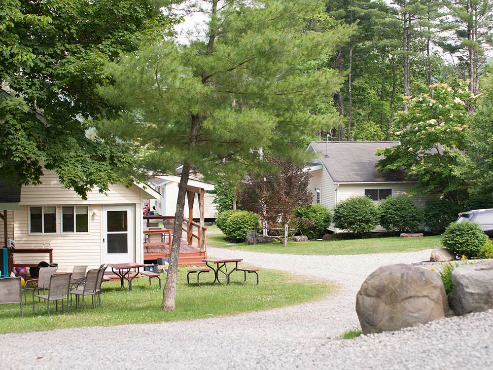 drive way leading to cabins among trees