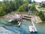 drone view of the lake shore with dock and deck