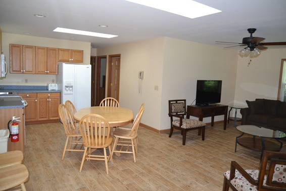 kitchen, dining area and dining room with wood floors