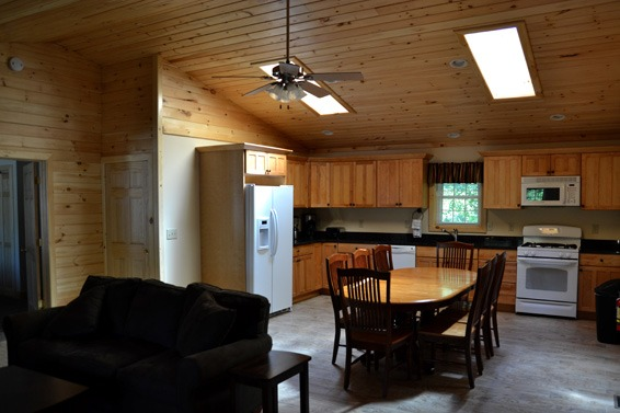 Kitchen with 2 skylights and table and chairs