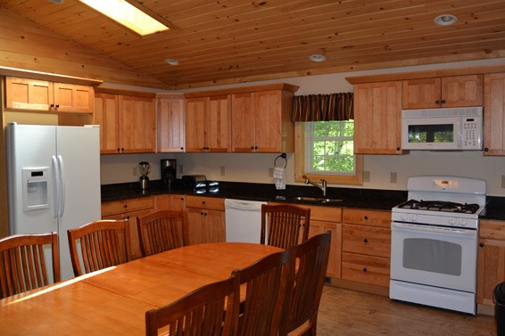 Wood cabinets in large kitchen with table